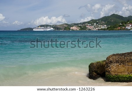 Beautiful caribbean blue water with a cruiseship in the background - stock photo