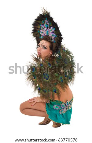 Beautiful carnival dancer sitting against isolated white background