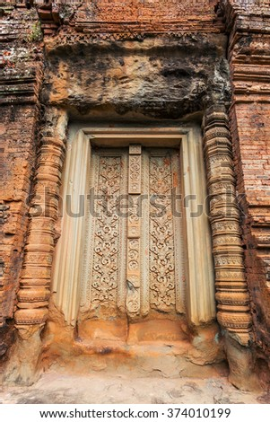 Beautiful carving pattern on the blind door on the top tower of Baksei Chamkrong temple, Angkor Wat complex, Cambodia