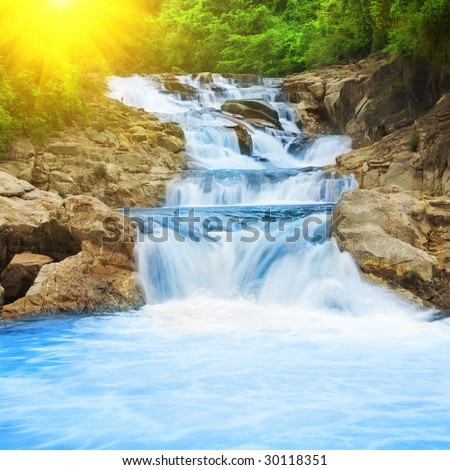 Beautiful cascade fall in tropical forest - stock photo