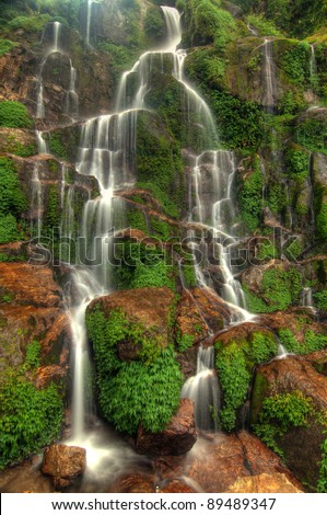Beautiful cascading Bakthang waterfall in the Himalayan valley in Sikkim, India - stock photo