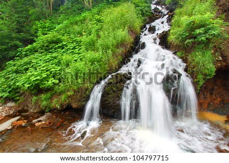 Beautiful cascading waterfall in the Black Hills National Forest of South Dakota - stock photo