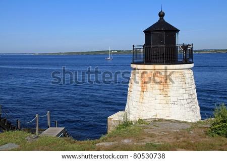 Beautiful Castle Hill lighthouse in Newport, Rhode Island overlooking the Atlantic Ocean, built in 1830 - stock photo