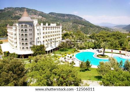 beautiful castle-resort in mountains - stock photo