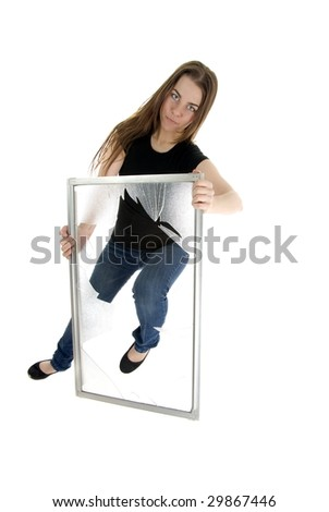 Beautiful casual business woman kicking through  window.  Breaking through the glass ceiling