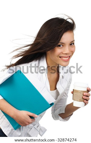 Beautiful casual businesswoman on the move with disposable coffee cup. Isolated on white.