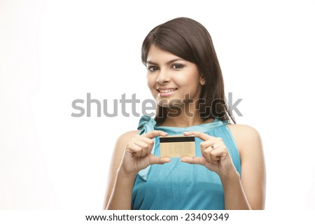 Beautiful casual girl holding a  credit card - stock photo