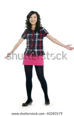 Beautiful casual girl smiling isolated over a white - stock photo