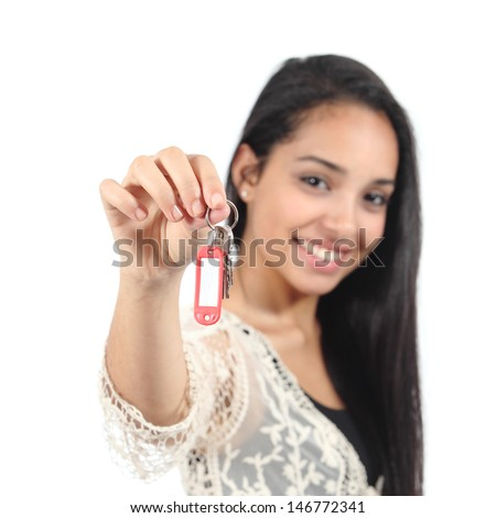 Beautiful casual muslim woman holding a house keys isolated on a white background           - stock photo