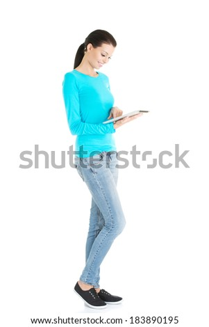 beautiful casual woman holding a tablet. Isolated on white. - stock photo