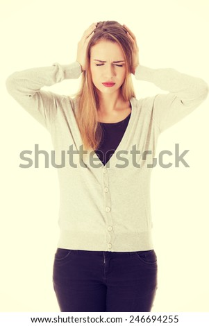 Beautiful casual woman is covering her ears. - stock photo