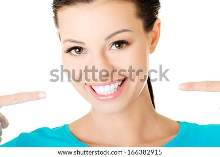 beautiful casual woman showing her perfect white teeth. Isolated on white. - stock photo