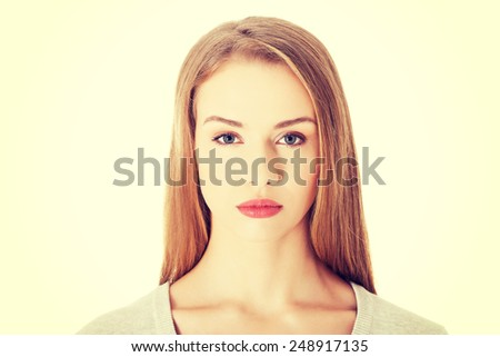 Beautiful casual woman with serious face. - stock photo