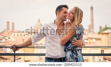 Beautiful casual young couple portrait outdoors in hotel terrace. - stock photo