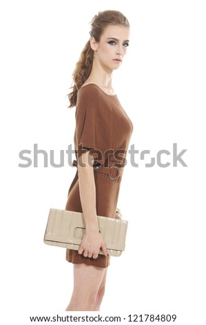 Beautiful casual young woman holding bag standing isolated - stock photo