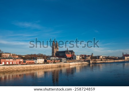 Beautiful cathedral of Magdeburg, river Elba and old town in the Spring morning, Magdeburg, Germany, 2015 - stock photo