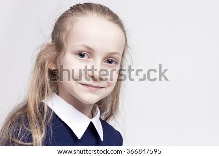 Beautiful Caucasian Blond Girl with Wonderful Deep Eyes. Posing Against White. Horizontal Image Orientation  - stock photo