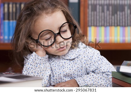 beautiful caucasian bored girl in the library - stock photo