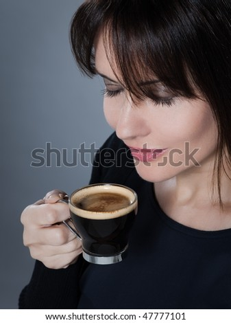 beautiful caucasian brunette drinking coffee on isolated background - stock photo