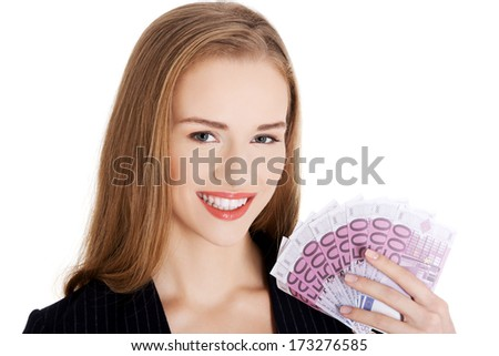 Beautiful caucasian business woman holding euro currency. Isolated on white. - stock photo