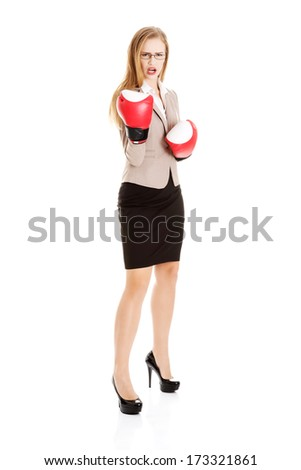 Beautiful caucasian business woman with boxing gloves. Isolated on white. - stock photo