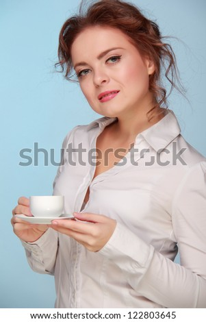Beautiful caucasian business woman with coffee cup