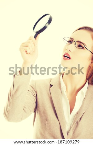 Beautiful caucasian business woman with magnifying glass. - stock photo