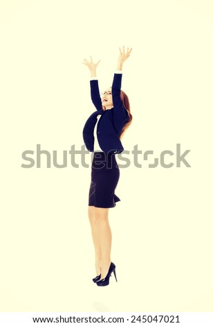 Beautiful caucasian businesswoman touching an abstract space above her. - stock photo