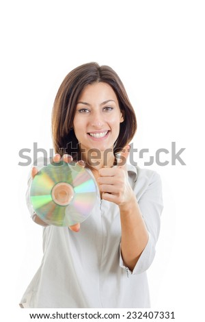 Beautiful caucasian casual smiling woman holding up compact disc or cd and looking at camera with thumbs up . Focus on face. Shot in studio isolated on white - stock photo