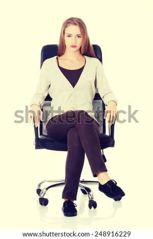 Beautiful caucasian casual woman sitting on a chair. - stock photo