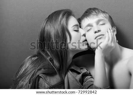 beautiful caucasian couple hugs and kisses - stock photo