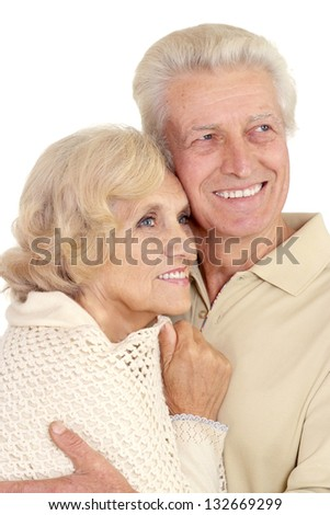 beautiful caucasian elderly couple over white background
