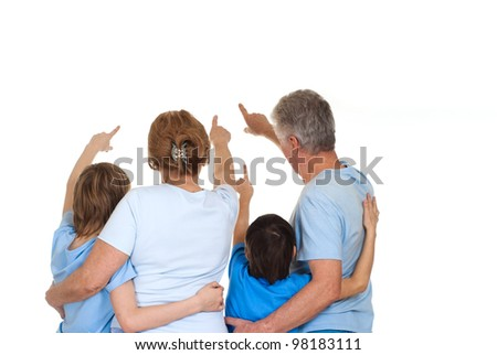 Beautiful Caucasian elderly couple with their grandchildren on a light background