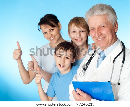 Beautiful Caucasian elderly doctor with a patient on a blue background