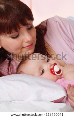 Beautiful Caucasian family of two on a light background