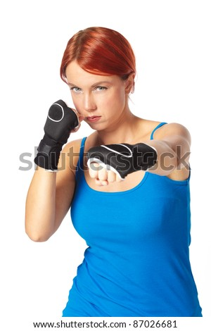 beautiful caucasian female boxer wearing boxing gloves - stock photo