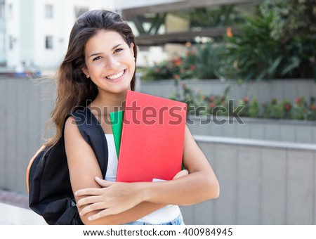 Beautiful caucasian female student in the city - stock photo