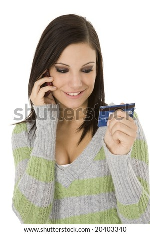 Beautiful Caucasian female using a credit card to make a purchase