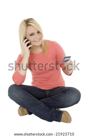 Beautiful Caucasian female using a credit card to make a purchase - stock photo