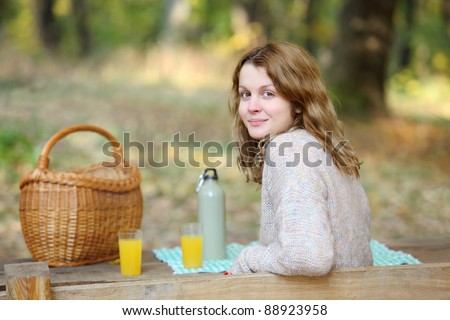 Beautiful caucasian girl at picnic in forest