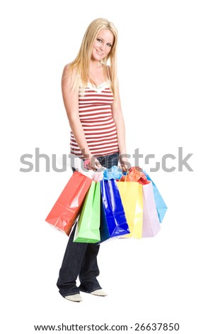 Beautiful caucasian girl carrying shopping bags