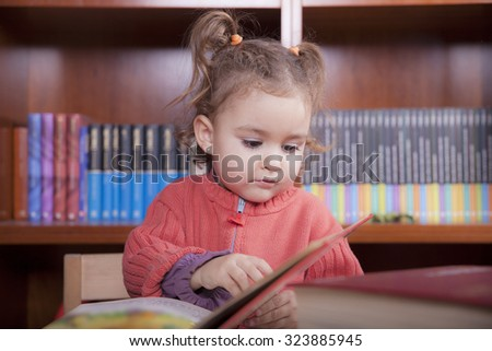 beautiful caucasian girl in the library - stock photo