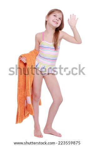 Beautiful caucasian little girl in swimsuit holding orange towel isolated over white background - stock photo