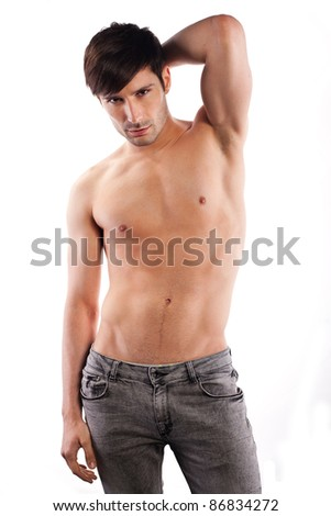 beautiful caucasian man half naked in gray jeans isolated on white.