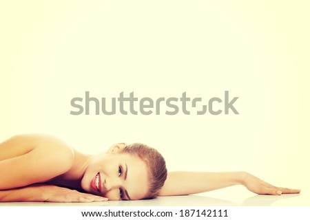 Beautiful caucasian naked woman lying down. Isolated on white. - stock photo
