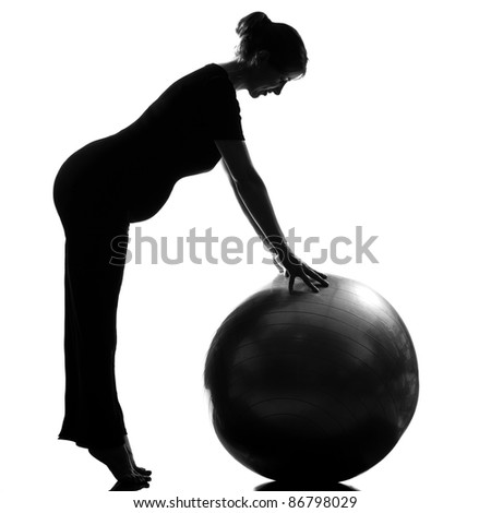 beautiful caucasian pregnant woman exercising fitness workut pilates with fitness ball in full length silhouette on studio isolated white background - stock photo