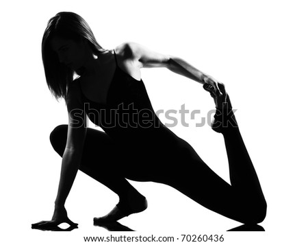 beautiful caucasian tall woman ballet dancer stretching warming up full length on studio isolated white background - stock photo