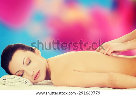 Beautiful caucasian woman during massage - stock photo
