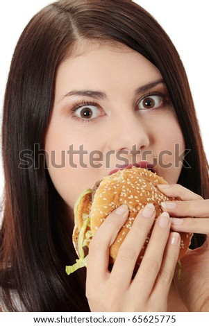 Beautiful caucasian woman eating hamburger. Isolated on white