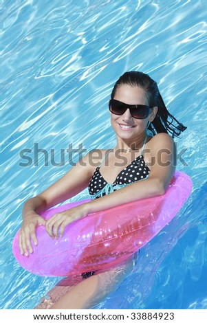 Beautiful Caucasian woman enjoying a day at the pool